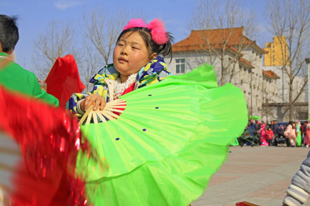 unrestrained: LUANNAN COUNTY - MARCH 4: traditional Chinese style yangko dance performances in the square, on march 4, 2015, Luannan County, Hebei province, China