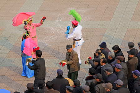 down beat: LUANNAN COUNTY - MARCH 7: traditional Chinese style yangko dance performances in the square, on march 7, 2015, Luannan County, Hebei province, China