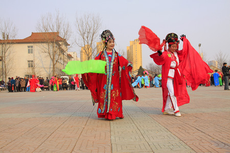 unrestrained: LUANNAN COUNTY - MARCH 6: traditional Chinese style yangko dance performances in the square, on march 6, 2015, Luannan County, Hebei province, China