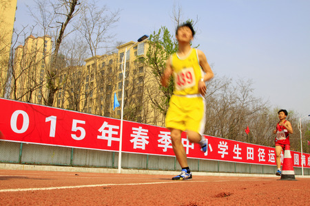 april 15: LUANNAN COUNTY - APRIL 15: long-distance runner ready to start, April 15, 2015, Luannan County, Hebei Province, China