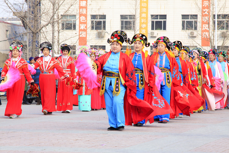 unrestrained: LUANNAN COUNTY - FEBRUARY 26: traditional Chinese style yangko dance performances in the square, on February 26, 2015, Luannan County, Hebei province, China