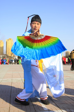 witty: LUANNAN COUNTY - FEBRUARY 26: traditional Chinese style yangko dance performances in the square, on February 26, 2015, Luannan County, Hebei province, China
