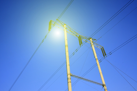 dazzle: telegraph poles in the blue sky background, closeup of photo