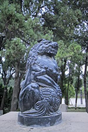 restore ancient ways: God beast statue in a park, closeup of photo