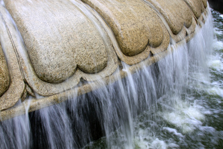 craft on marble: fountain in a park, closeup of photo Stock Photo