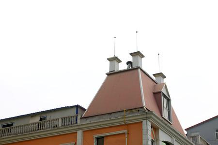 attic window: building roof, closeup of photo