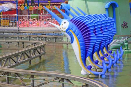 orbital: swordfish sculptures and orbital in a playground, closeup of photo