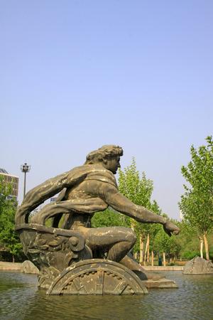 apollo: sun god Apollo sculpture in a water park, closeup of photo