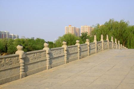 restore ancient ways: Stone bridge and rail, closeup of photo