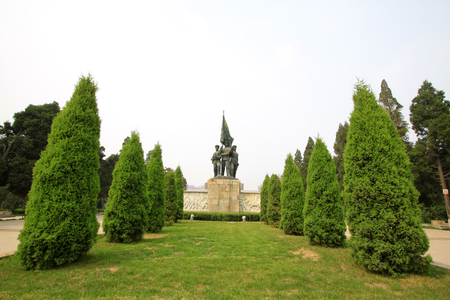 north china: Shijiazhuang - April 28: warrior statue and cypress trees in the north China military martyrs cemetery, on April 28, 2015, shijiazhuang city, hebei province, China Editorial
