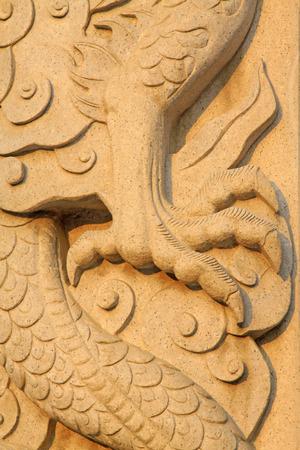 restore ancient ways: dragon claw stone sculpture, closeup of photo
