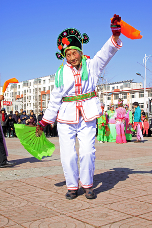 customs and celebrations: LUANNAN COUNTY - MARCH 1: traditional Chinese style yangko dance performances in the square, on march 1, 2015, Luannan County, Hebei province, China