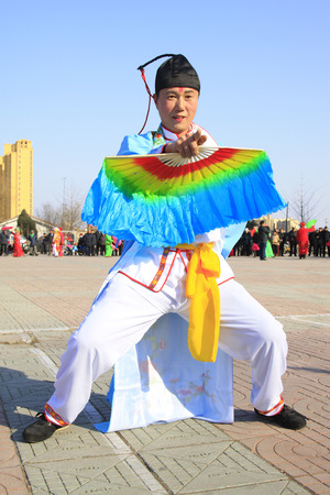 customs and celebrations: LUANNAN COUNTY - FEBRUARY 26: traditional Chinese style yangko dance performances in the square, on February 26, 2015, Luannan County, Hebei province, China