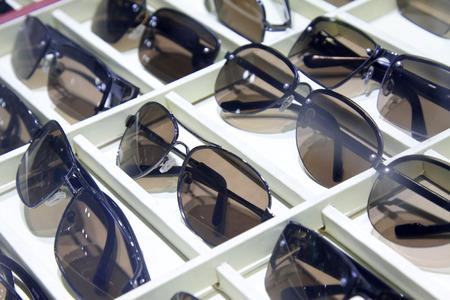 the shelf: sunglasses on the shelf, closeup of photo