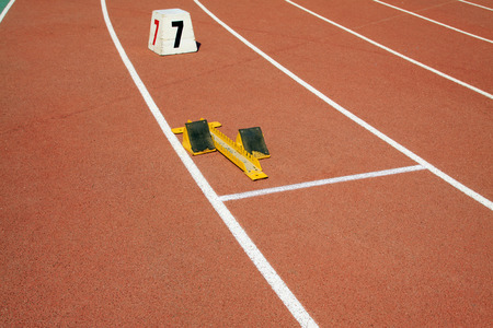 serial: starting block and serial number mark on the plastic runway