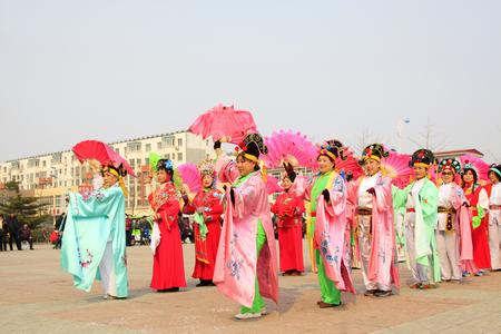 customs and celebrations: LUANNAN COUNTY - MARCH 7: traditional Chinese style yangko dance performances in the square, on march 7, 2015, Luannan County, Hebei province, China