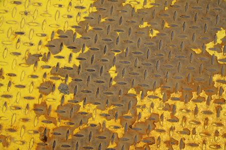 friction: Paint peeling checkered plate, closeup of photo Stock Photo
