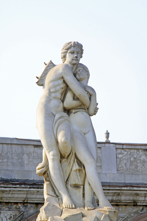 Couples sculpture - Cupid and psyche in a park, closeup of photo