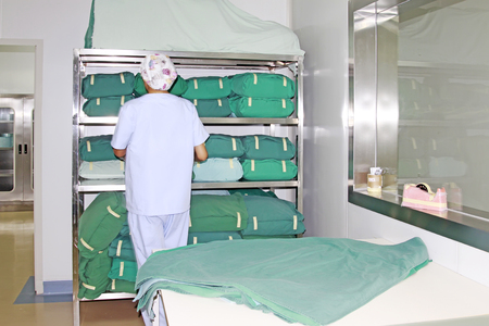 disinfection: a staff finishing disinfection clean package in the hospital, luannan county, hebei province, China