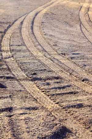 indentation: wheel trace on the ground, closeup of photo
