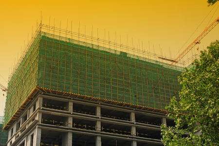 uncompleted: Buildings and protective screening, closeup of photo