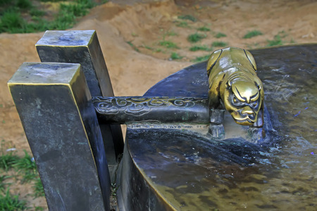 restore ancient ways: ancient Chinese traditional bronze beast sculpture, closeup of photo