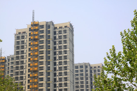 unfinished: Unfinished buildings and green, closeup of photo