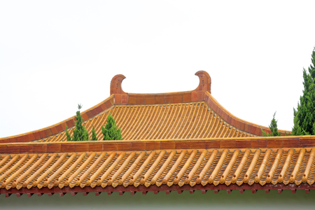 ancients: traditional Chinese architectural style yellow glazed tile roof, closeup of photo