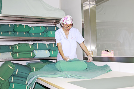 Luannan - June 29: a staff finishing disinfection clean package in the hospital, on June 29, 2015, luannan county, hebei province, China