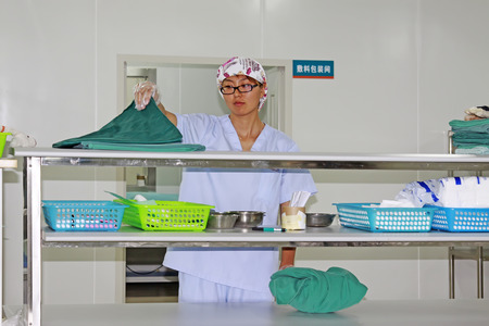 disinfection: Luannan - June 29: a medical staff arrange disinfection clean package in the hospital, on June 29, 2015, luannan county, hebei province, China
