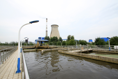 pollution free: Sewage treatment plant oxidation ditch and water cooling tower, closeup of photo Stock Photo