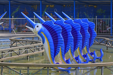 orbital: dolphins and orbital in a playground, closeup of photo
