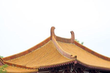 restore ancient ways: traditional Chinese architectural style yellow glazed tile roof, closeup of photo
