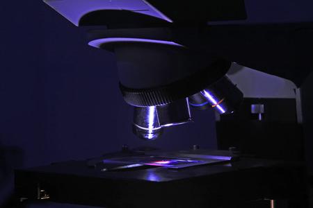 medical technical equipment: Microscopic lens in dark environment, closeup of photo