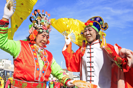customs and celebrations: LUANNAN COUNTY - MARCH 4: traditional Chinese style yangko dance performances in the square, on march 4, 2015, Luannan County, Hebei province, China