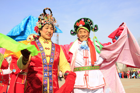 unrestrained: LUANNAN COUNTY - MARCH 5: traditional Chinese style yangko dance performances in the square, on march 5, 2015, Luannan County, Hebei province, China