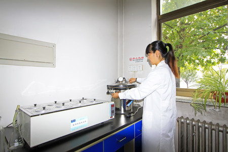 experimenter: Luannan County - September 28: Technical personnel and high pressure sterilization experiments in the lab, on September 28, 2015, luannan county, hebei province, China