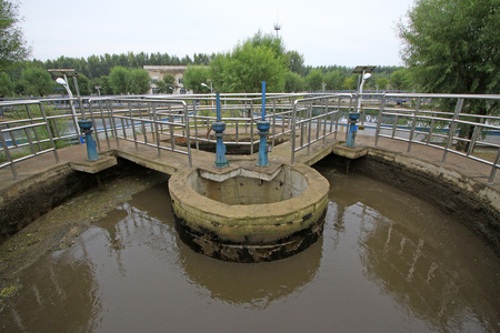 pollution free: Sewage treatment plant distribution well, closeup of photo