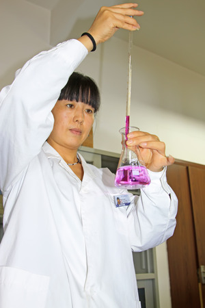 experimenter: Luannan County - September 28: technician test oxygen consumption in the laboratory, on September 28, 2015, luannan county, hebei province, China Editorial