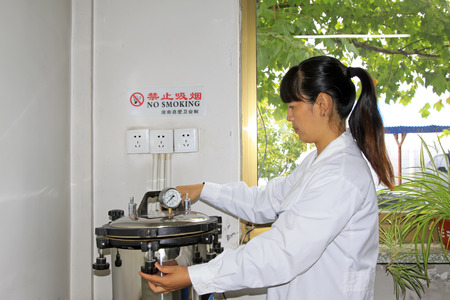 sterilization: Luannan County - September 28: Technical personnel and high pressure sterilization experiments in the lab, on September 28, 2015, luannan county, hebei province, China