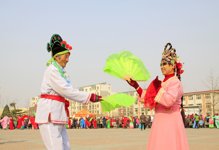 ms: LUANNAN COUNTY - MARCH 6: traditional Chinese style yangko dance performances in the square, on march 6, 2015, Luannan County, Hebei province, China