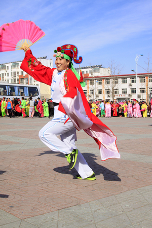 luxuriant: LUANNAN COUNTY - MARCH 4: traditional Chinese style yangko dance performances in the square, on march 4, 2015, Luannan County, Hebei province, China