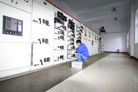 automated tooling: Luannan County - September 28: technicians are maintenance equipment in the transformer room, on September 28, 2015, luannan county, hebei province, China