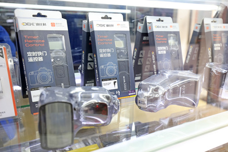 remote controls: Tangshan - March 6: photography remote controls and flash on the shelf, in a photographic equipment store, on March 6, 2016, tangshan city, hebei province, China Editorial