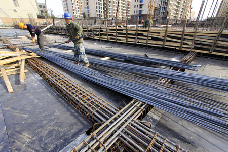 handling: Luannan - January 18: workers in handling thread reinforcing steel bar, in the construction site, on January 18, 2015, luannan county, hebei province, China