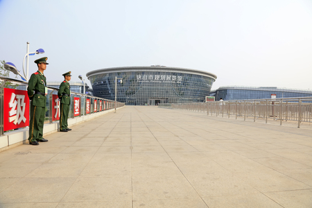 the exhibition hall: Tangshan city - April 29: Armed police soldiers on guard outside of Tangshan city planning exhibition hall, April 29, 2016, Tangshan city, china