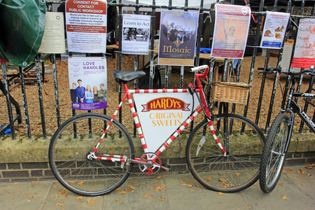 campus tour: Cambridge - October 3: corporate promotional announcements and bicycle in the street, on October 3, 2015, Cambridge, UK.