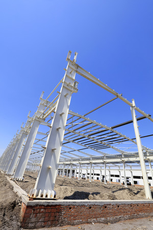 steel girder truss under blue sky, closeup of photo