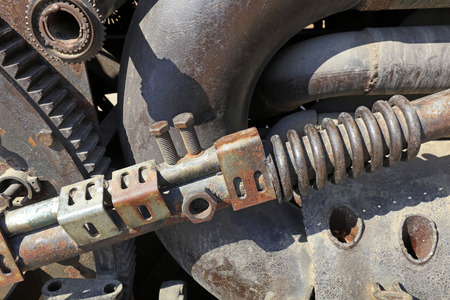 waste products: rusty mechanical components, closeup of photo