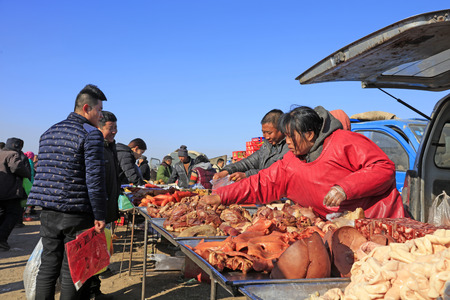 fruit trade: Luannan County - February 1: customers buying cooked food in the rural market, February 1, 2016, luannan county, hebei province, China.